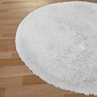 tapis rond blanc ou cr me inspiration luxe. Black Bedroom Furniture Sets. Home Design Ideas