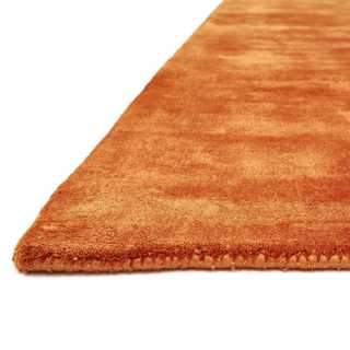 Tapis de luxe uni orange en viscose